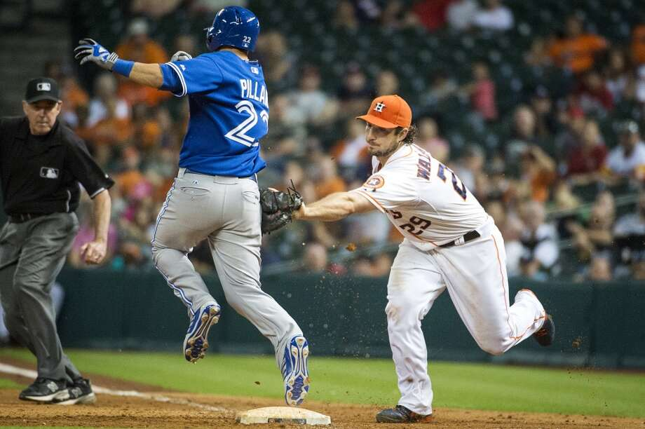 Kevin Pillar is safe at first as he beats the tag from Astros first baseman Brett Wallace. Photo: Smiley N. Pool, Houston Chronicle