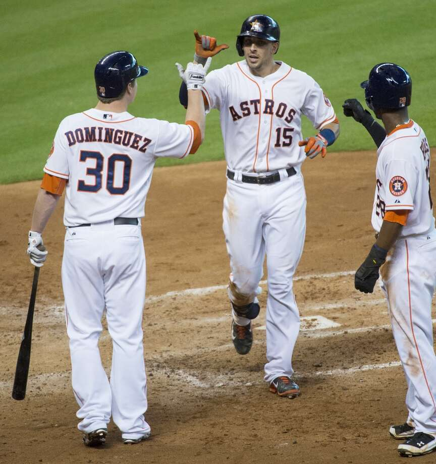 Astros catcher Jason Castro celebrates with third baseman Matt Dominguez and left fielder L.J. Hoes after hitting a two-run home run. Photo: Smiley N. Pool, Houston Chronicle