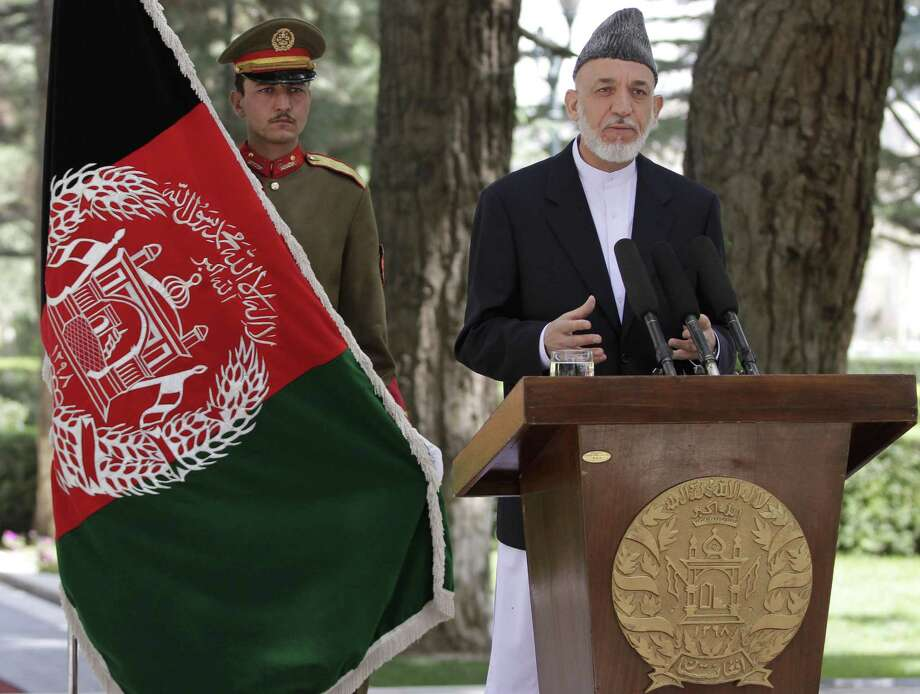 Afghan President Hamid Karzai denies that he favors any candidate to succeed him, saying his only role would be to cast a ballot next April like any other citizen. Photo: Ahmad Jamshid / Associated Press