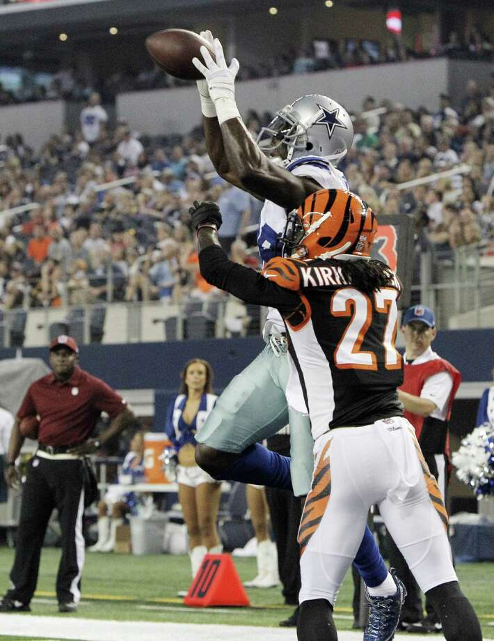 Cowboys wide receiver Dez Bryant, top, catches a touchdown pass over Bengals cornerback Dre Kirkpatrick during the first half of Saturday's game. Photo: Brandon Wade, MBR / Fort Worth Star-Telegram