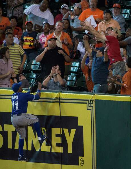 Blue Jays right fielder Rajai Davis didn't quite have enough hops to reach one of Jason Castro's two homers Saturday night at Minute Maid Park. Photo: Smiley N. Pool / © 2013  Smiley N. Pool