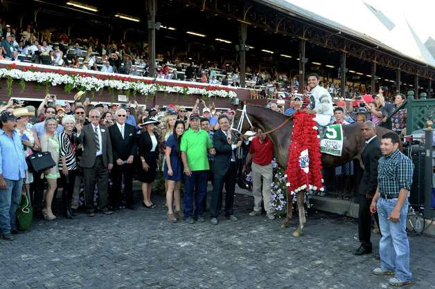Will Take Charge with jockey Luis Saez, stands in the winner's circle surrounded by connections after winning the 144th running of The Travers Stakes Aug 24, 2013, at the Saratoga Race Course in Saratoga Springs, N.Y. (Skip Dickstein/Times Union) Photo: SKIP DICKSTEIN