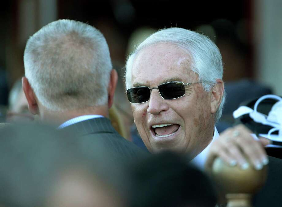 Will Take Charge's trainer D. Wayne Lukas is all smiles as he is greeted by his protege Todd Pletcher, left after winning the 144th running of The Travers Stakes Aug 24, 2013, at the Saratoga Race Course in Saratoga Springs, N.Y. (Skip Dickstein/Times Union) Photo: SKIP DICKSTEIN