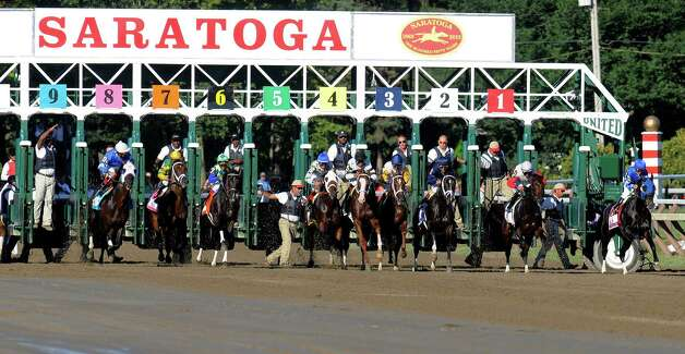 The field breaks from the starting gate in the Travers Stakes horse race at Saratoga Race Course in Saratoga Springs, N.Y., Saturday, Aug. 24, 2013.  Will Take Charge (5), with jockey Luis Saez aboard, won the race. (AP Photo /Hans Pennink) ORG XMIT: NYHP110 Photo: Hans Pennink / FR58980 AP