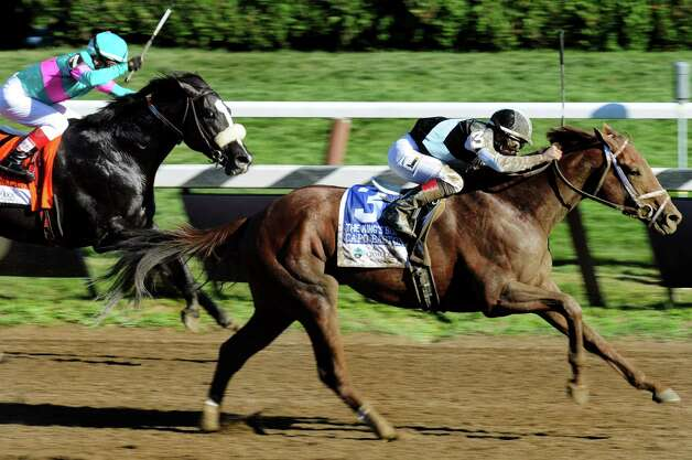 Capo Bastone with Irad Ortiz Jr. up, right, overtakes Mentor Cane with Edgar Prado up in the 29th Running of The Foxwoods King's Bishop on Travers Day on Saturday, Aug. 24, 2013, at Saratoga Race Course in Saratoga Springs, N.Y. (Cindy Schultz / Times Union) Photo: Cindy Schultz / 00023621A