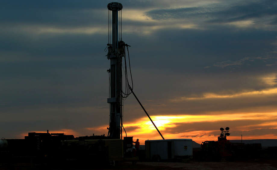 Another 30-foot section of pipe is added June 21 to a contract rig drilling a wildcat well in Presidio County between Alpine and Marfa. At this time, the rig had drilled more than 2,100 feet below.