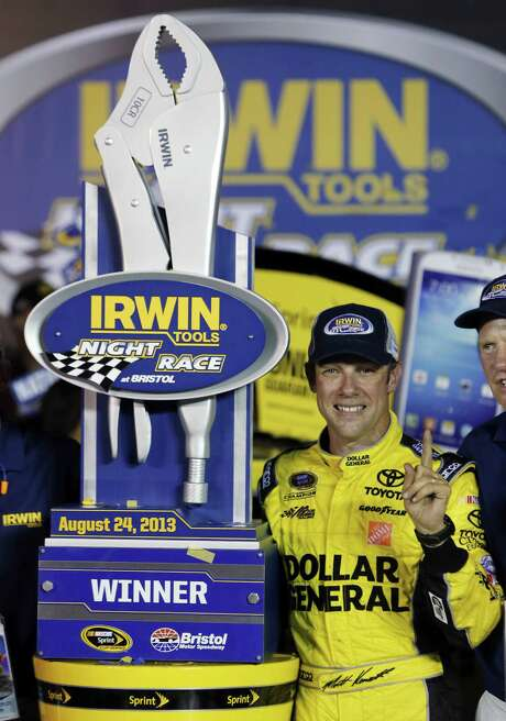 Matt Kenseth enjoys the moment with the trophy in Victory Lane after his Sprint Cup victory Saturday night at Bristol Motor Speedway. Photo: Wade Payne / Associated Press