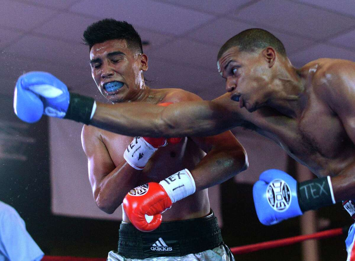 Miguel Pizarro lands a right on Luis Torres during their bout at the San Antonio Events Center on Saturday, Aug. 24, 2013. Torres won the fight.