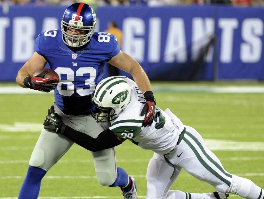 Giants tight end Brandon Myers (left) is tackled by Jets safety Antonio Allen in East Rutherford, N.J. Photo: Bill Kostroun / Associated Press