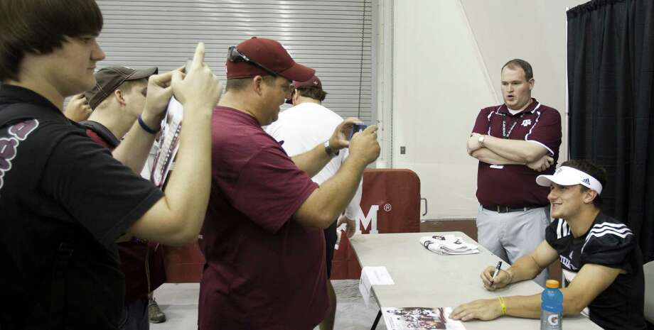 "If the pressure of the NCAA's investigation was getting to him, Texas A&M quarterback Johnny Manziel didn't indicate it during Saturday's ""Meet The Aggies."" Photo: Brett Coomer / Houston Chronicle"