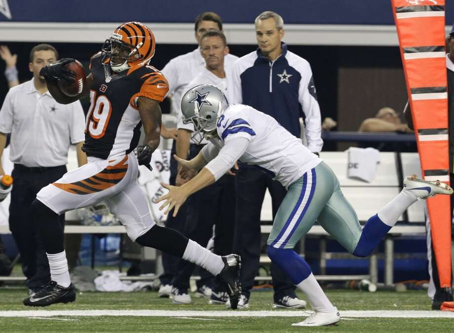 Cincinnati Bengals' Brandon Tate (19) runs away from a tackle attempt by Dallas Cowboys punter Chris Jones (6) on his way to the end zone for a score on a punt return in the first half of a preseason NFL football game, Saturday, Aug. 24, 2013, in Arlington, Texas. (AP Photo/LM Otero) Photo: Associated Press