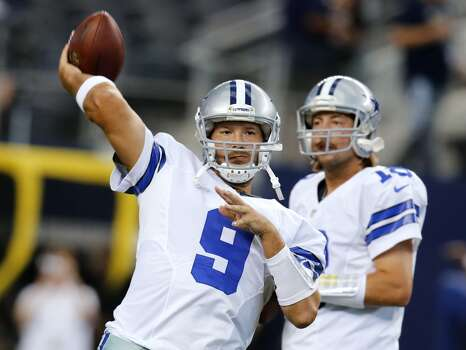 Dallas Cowboys quarterback Tony Romo (9) passes as players warm up for an NFL preseason football game against the Cincinnati Bengals, Saturday, Aug. 24, 2013, in Arlington, Texas. Cowboys backup quarterback Kyle Orton is at right. (AP Photo/Sharon Ellman) Photo: Associated Press