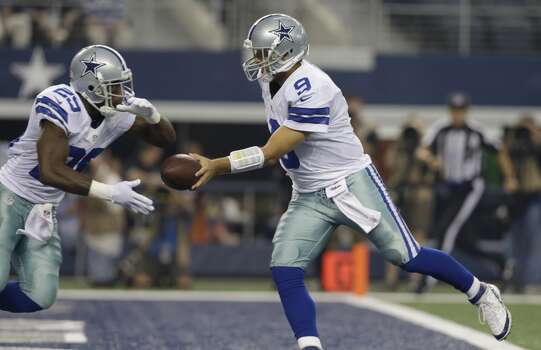 Dallas Cowboys quarterback Tony Romo (9) hands off to DeMarco Murray (29) during the first half of an preseason NFL football game, Saturday, Aug. 24, 2013, in Arlington, Texas. (AP Photo/LM Otero) Photo: Associated Press