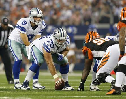 Dallas Cowboys quarterback Tony Romo (9) stands behind center Travis Frederick (70) during the first half of a preseason NFL football game against the Cincinnati Bengals Saturday, Aug. 24, 2013, in Arlington, Texas. (AP Photo/Sharon Ellman) Photo: Associated Press
