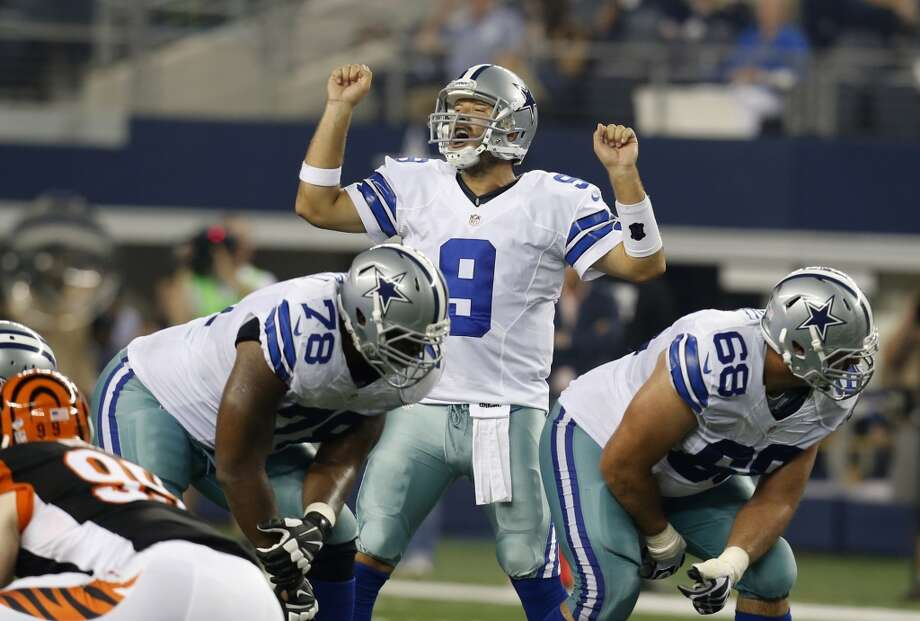 Dallas Cowboys' Tony Romo (9) signals at the line of scrimmage as tackle Jermey Parnell (78) and tackle Doug Free (68) provide protection during the first half of a preseason NFL football game against the Cincinnati Bengals, Saturday, Aug. 24, 2013, in Arlington, Texas. (AP Photo/Sharon Ellman) Photo: Associated Press