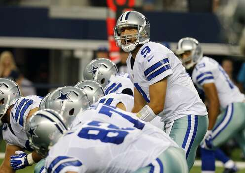 Dallas Cowboys quarterback Tony Romo (9) signals at the line of scrimmage during the first half of a preseason NFL football game against the Cincinnati Bengals, Saturday, Aug. 24, 2013, in Arlington, Texas.  (AP Photo/Sharon Ellman) Photo: Associated Press