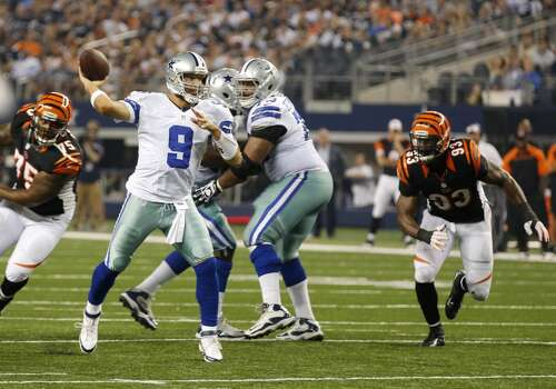 Dallas Cowboys quarterback Tony Romo (9) passes under pressure from Cincinnati Bengals defensive tackle Devon Still (75) and defensive end Michael Johnson (93) during the first half of a preseason NFL football game, Saturday, Aug. 24, 2013, in Arlington, Texas. (AP Photo/Sharon Ellman) Photo: Associated Press
