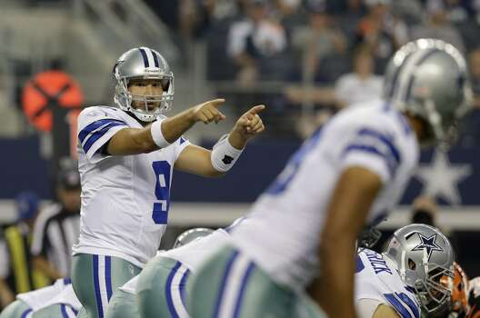 Dallas Cowboys quarterback Tony Romo (9) signals at the line of scrimmage during the first half of a preseason NFL football game against the Cincinnati Bengals, Saturday, Aug. 24, 2013, in Arlington, Texas. (AP Photo/LM Otero) Photo: Associated Press