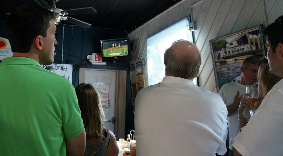 Fans of the Westport Little League gathered Saturday at the Black Duck Cafe to watch broadcast of the team play for the Little League World Series' U.S. championship against California. Westport lost 12-1. Photo: Genevieve Reilly / Westport News contributed