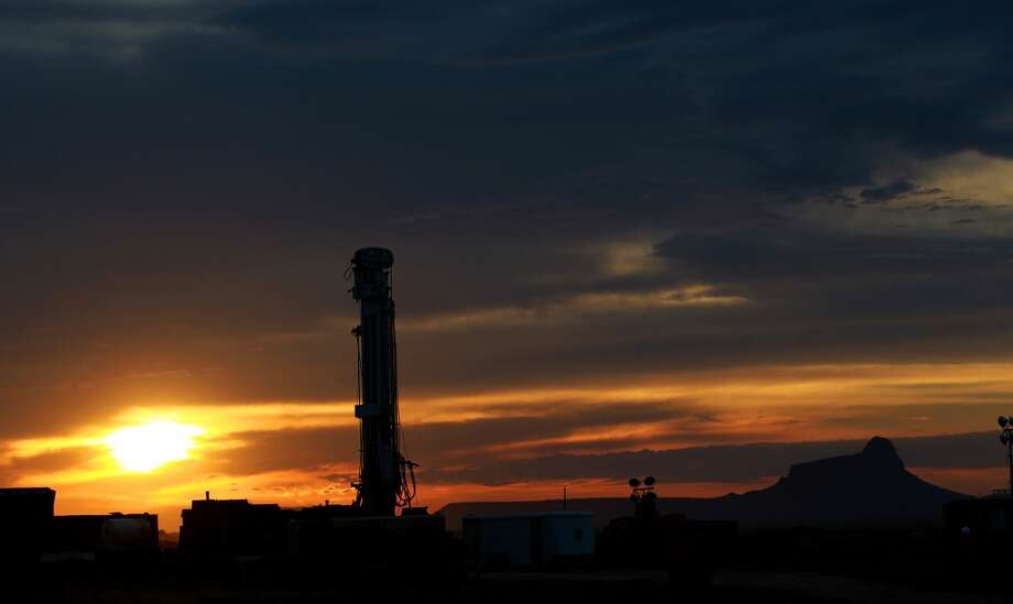The sun rises behind the Barrett Brothers Number 1 independent drilling rig Friday June 21, 2013. The rig is being drilled in Presidio County between Alpine and Marfa, Texas near the Marfa Lights viewing station. Photo: JOHN DAVENPORT, SAN ANTONIO EXPRESS-NEWS