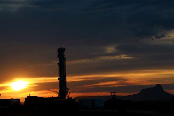 The sun rises behind the Barrett Brothers Number 1 independent drilling rig Friday June 21, 2013. The rig is being drilled in Presidio County between Alpine and Marfa, Texas near the Marfa Lights viewing station.