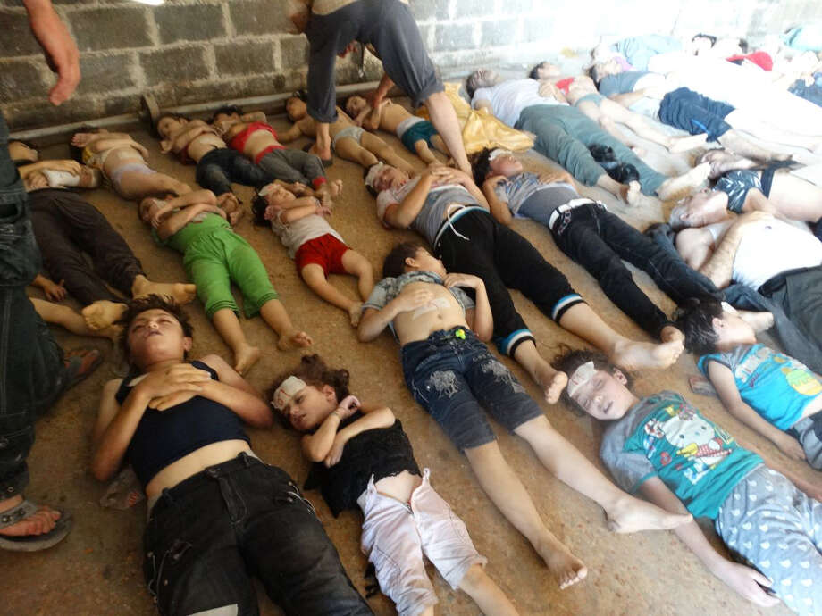 "This image provided by Shaam News Network on Thursday, Aug. 22, 2013, which has been authenticated based on its contents and other AP reporting, purports to show bodies of victims of an attack on Ghouta, Syria on Wednesday, Aug. 21, 2013. Syrian government forces pressed their offensive in eastern Damascus on Thursday, bombing rebel-held suburbs where the opposition said the regime had killed more than 100 people the day before in a chemical weapons attack. The government has denied allegations it used chemical weapons in artillery barrages on the area known as eastern Ghouta on Wednesday as ""absolutely baseless."" Photo: AP"