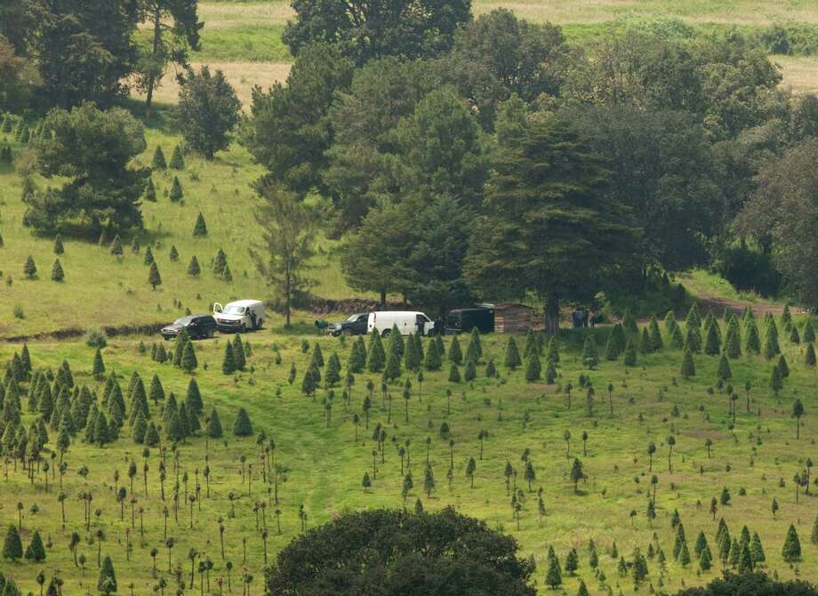 Police vehicles block the entrance to a ranch where a mass grave was found in Tlalmanalco, Mexico, Thursday, Aug. 22, 2013. Mexican authorities said Thursday that they have found a mass grave east of Mexico City and are testing to determine if it holds some of the 12 people who vanished from a bar in an upscale area of the capital nearly three months ago. Photo: AP