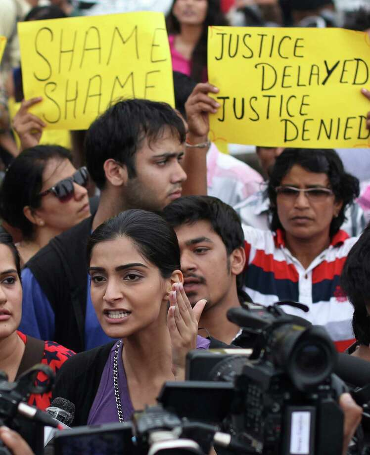 Indian Bollywood actress Sonam Kapoor center, speaks to media as she participates in a protest against the gang rape of a photojournalist  in Mumbai, India, Sunday, Aug. 25, 2013. Police on Sunday arrested the last of five men wanted in the gang rape of a 22-year-old Indian woman in Mumbai, and said charges would be filed soon in a case that has incensed the public and fueled debate over whether women can be safe in India. Photo: AP