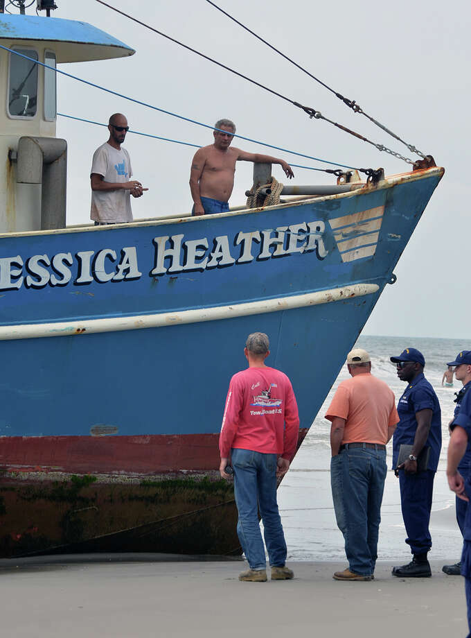 Crew members remain aboard the fishing vessel Jessica Heather, which ran aground on the beach in Atlantic City, N.J., Monday, Aug. 19, 2013. The Jessica Heather, a 56-foot fishing boat, has run aground near Caesar's Pier in Atlantic City. Photo: AP