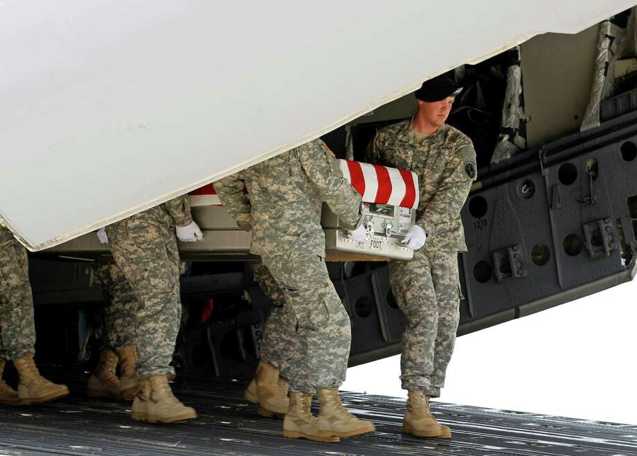 An Army carry team carries the transfer case containing the remains of Army Master Sgt. George A. Bannar Jr. of Orange, Va. upon arrival at Dover Air Force Base, Del. on Thursday, Aug. 22,  2013. The Department of Defense announced the death of Bannar Jr. who was supporting Operation Enduring Freedom in Afghanistan. Photo: AP