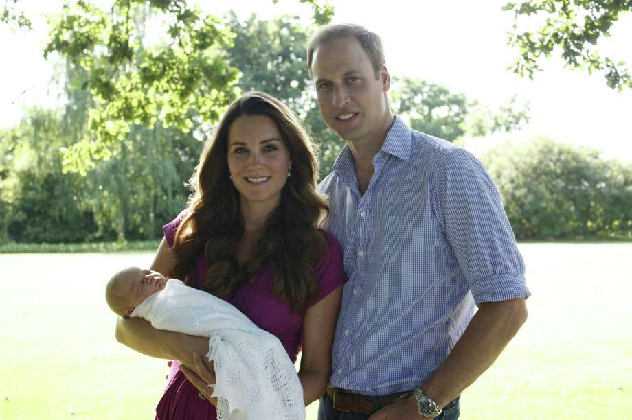 This image taken by Michael Middleton, the Duchess's father, in early August 2013 and supplied by Kensington Palace, shows the Duke and Duchess of Cambridge with their son, Prince George, in the garden of the Middleton family home in Bucklebury, England. (AP Photo/Michael Middleton/TRH The Duke and Duchess of Cambridge )  Photo: AP