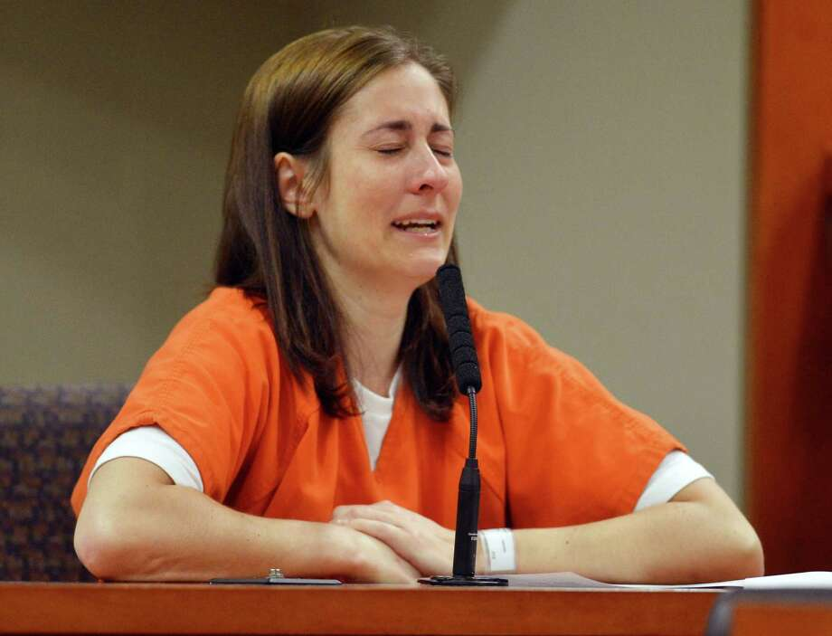 Andrea Sneiderman gives a statement during her sentencing hearing Tuesday, Aug. 20, 2013, in Decatur, Ga. A judge has sentenced Sneiderman, who has been convicted of lying to investigators about the shooting death of her husband outside a preschool, to spend the next four years in prison. Photo: AP