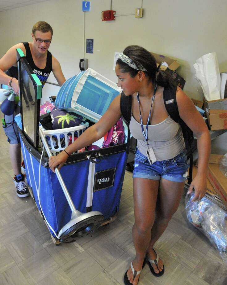 Western Connecticut State University students move in at the university's Midtown campus in Danbury, Conn. Sunday, Aug. 25, 2013. Photo: Michael Duffy / The News-Times