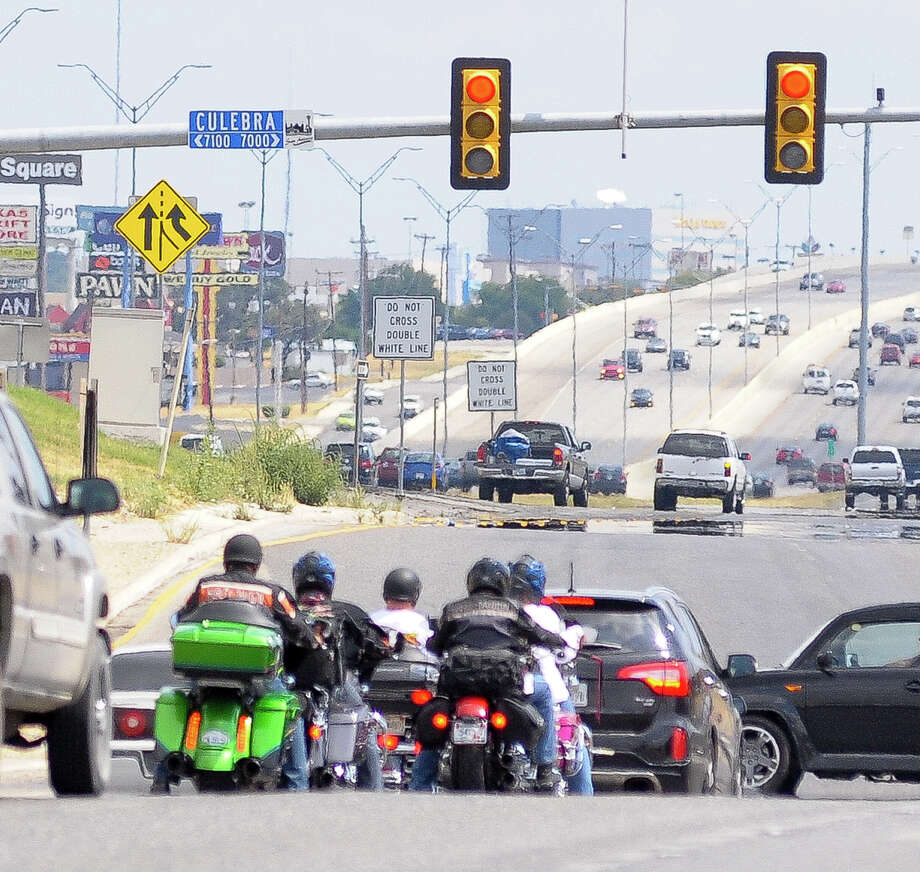 A small group of Harley Davidson riders wait for at stoplight at 410 and Culebra St. as they begin their ride to Milwaukee, Wis., to celebrate the manufacturer's 110th anniversary. Photo: Robin Jerstad