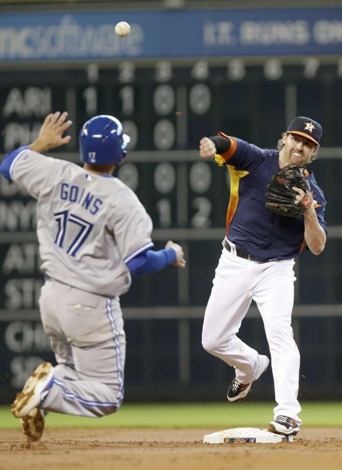 Aug. 25: Blue Jays 2, Astros 1  Jake Elmore of the Astros tries to make a play on defense against the Blue Jays. Photo: Pat Sullivan, Associated Press
