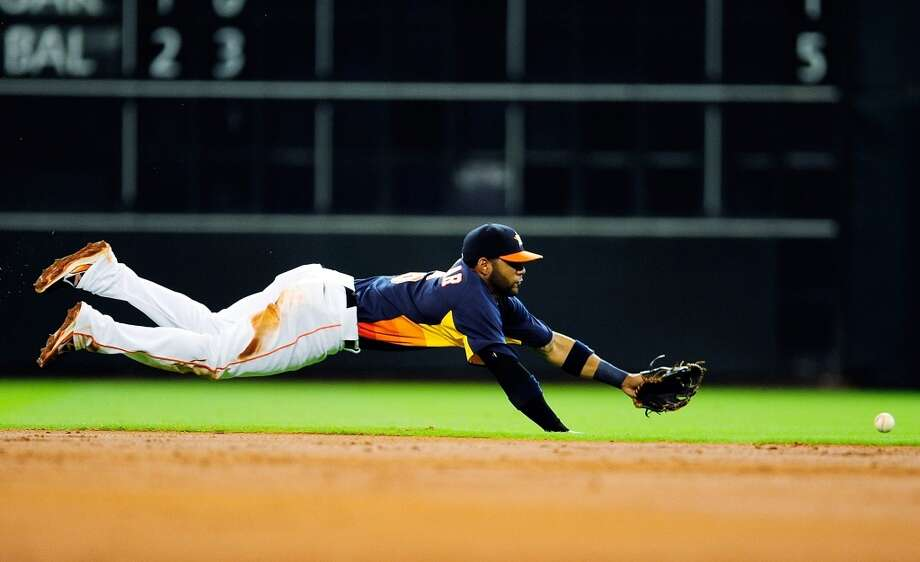 Jonathan Villar of the Astros tries to make a play on defense against the Blue Jays. Photo: Stacy Revere, Getty Images