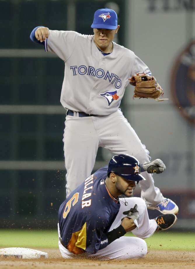 Astros shortstop Jonathan Villar is forced out at second base against the Blue Jays. Photo: Pat Sullivan, Associated Press