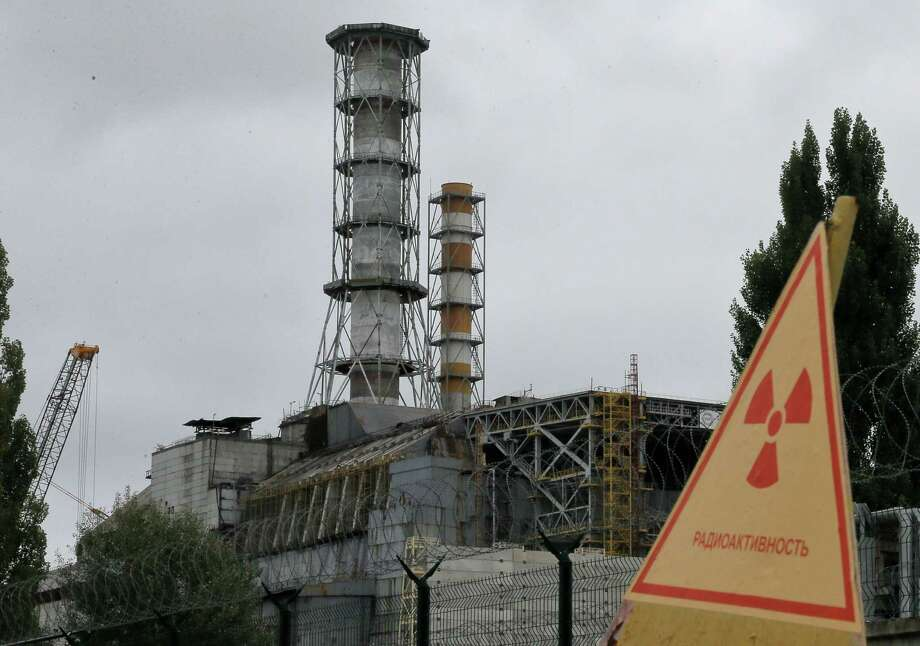 A chimney stands over the damaged reactor at the Chernobyl nuclear power plant in Chernobyl, Ukraine, on Sunday, Aug. 25, 2013, the scene of the world's worst nuclear accident. The No. 4 reactor at Chernobyl nuclear power plant was the scene of a major explosion in 1986, resulting in the evacuation of the nearby town and the ongoing legacy of protecting against any possible radiation leaks. Photo: AP