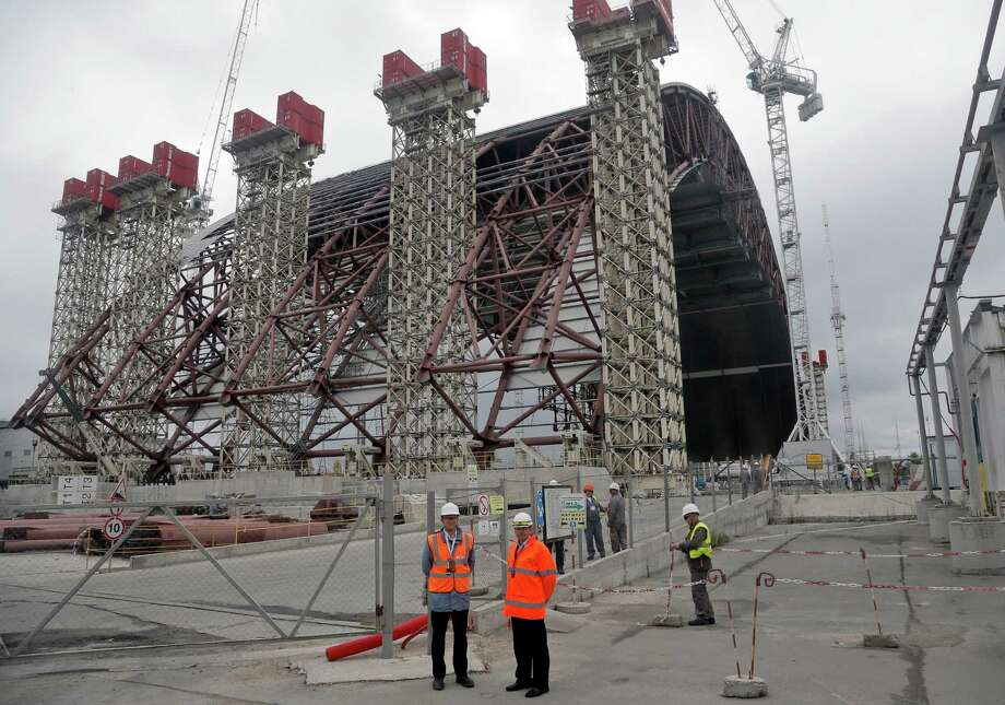 A gigantic steel arch under construction to cover the remnants of the exploded reactor at the Chernobyl nuclear power plant, in Chernobyl, Ukraine, on Sunday, Aug. 25, 2013, the scene of the world's worst nuclear accident. The No. 4 reactor at Chernobyl nuclear power plant was the scene of a major explosion in 1986, resulting in the evacuation of the nearby town and the ongoing legacy of protecting against any possible radiation leaks. Photo: AP