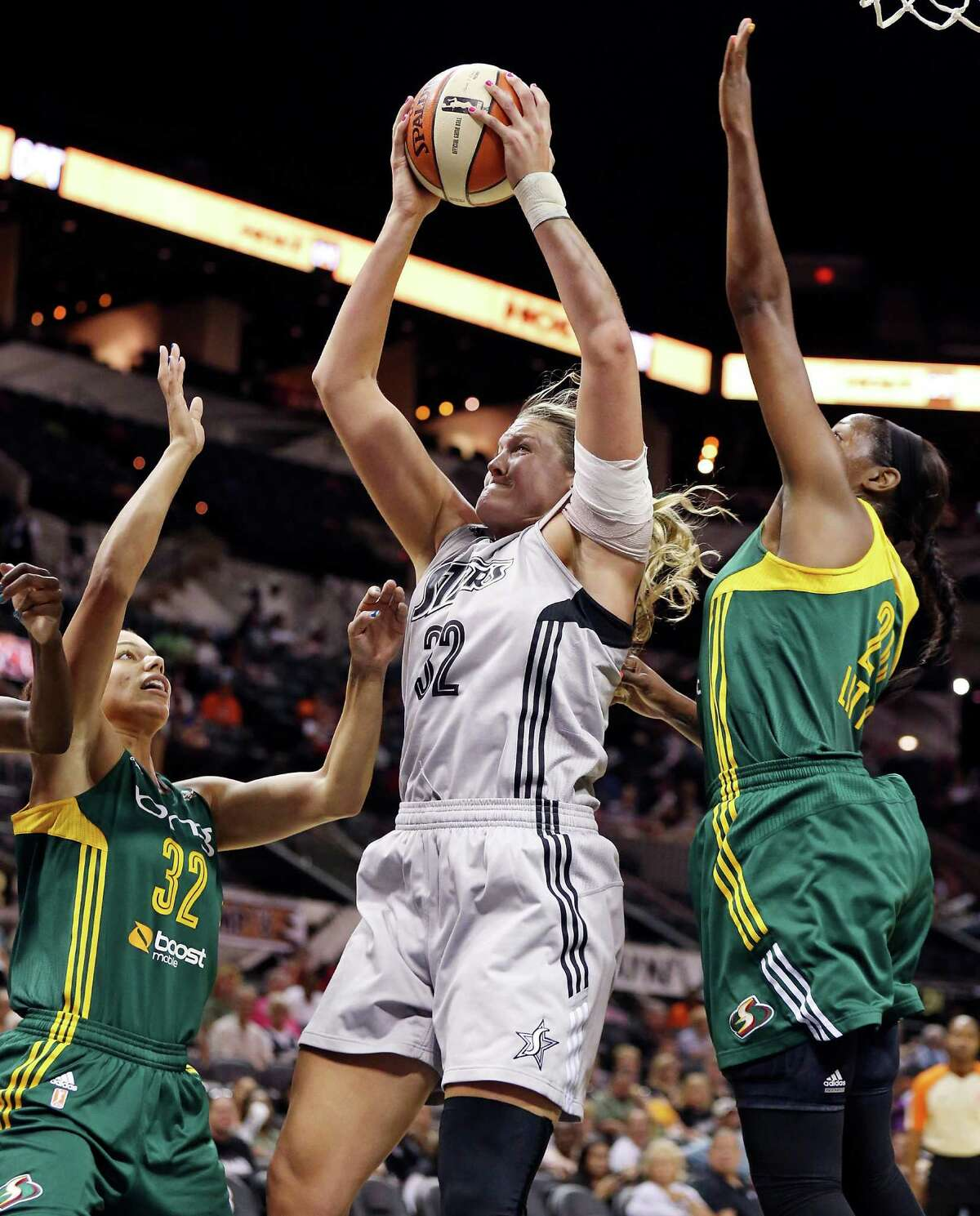 Silver Stars' Jayne Appel grabs for a rebound between Seattle Storm's Alysha Clark (left) and Camille Little during first half action Sunday Aug. 25, 2013 at the AT&T Center.