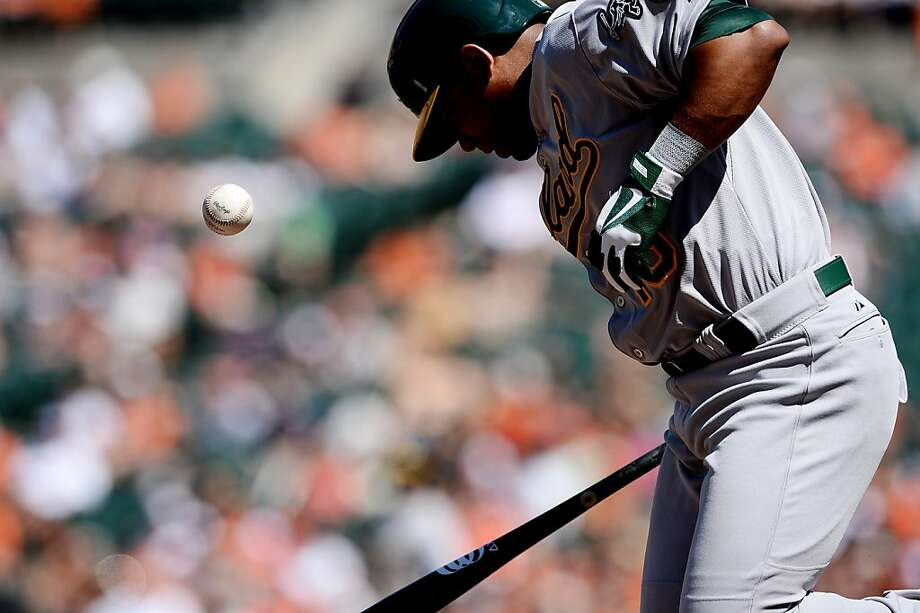 BALTIMORE, MD - AUGUST 25: Alberto Callaspo #18 of the Oakland Athletics is hit by a pitch against the Baltimore Orioles in the third inning at Oriole Park at Camden Yards on August 25, 2013 in Baltimore, Maryland. (Photo by Patrick Smith/Getty Images) Photo: Patrick Smith, Getty Images