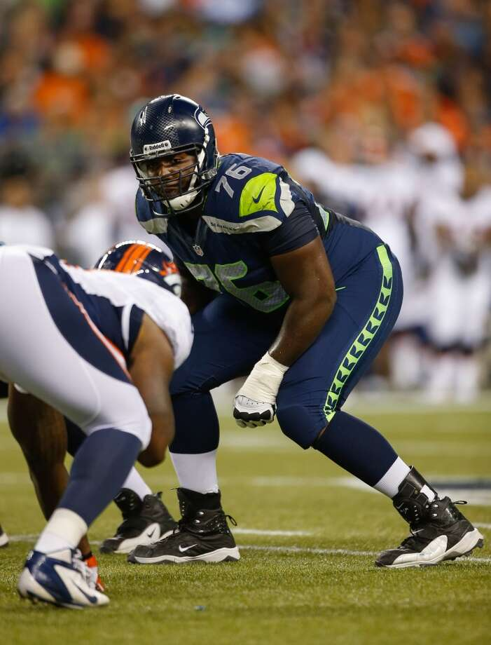 Russell Okung lines up against the Denver Broncos at CenturyLink Field on August 17, 2013. Photo: Otto Greule Jr, Getty Images
