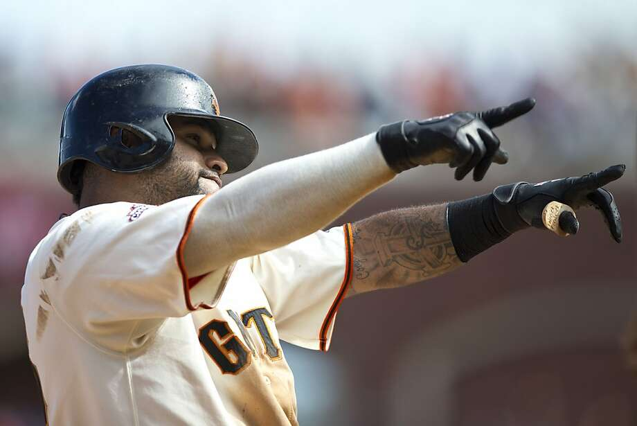 Pablo Sandoval celebrates after hitting a two-run triple in the eighth as the Giants beat the Pirates for the second game in a row. Photo: Jason O. Watson, Getty Images