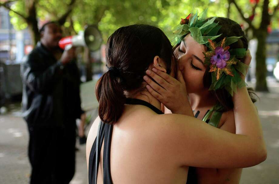 Simone Vieco and Mary Richardson kiss in protest to Christian religious groups at Occidental Park during the annual Slutwalk march Sunday Aug. 25, 2013 in Seattle. The group then marched to Westlake Center. Photo: SY BEAN, SEATTLEPI.COM / SEATTLEPI.COM