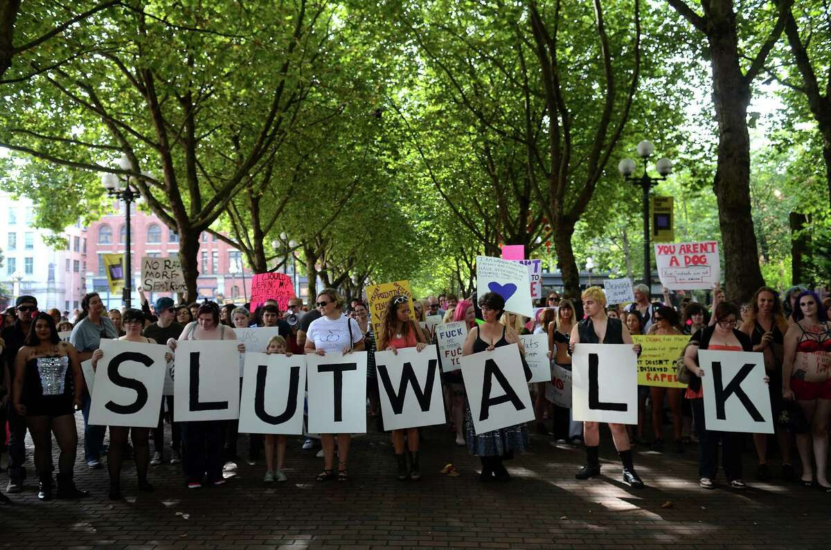Attendees chanted in protest with signs and slogans during the annual Slutwalk march Sunday, Aug. 25, 2013, in Seattle. Attendees of the walk protested rape culture and gender-based violence in the United States.