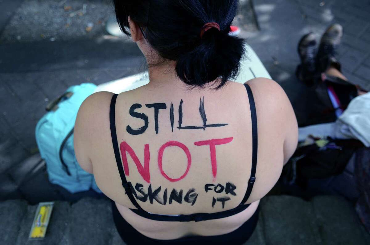 Attendees painted themselves with signs and slogans during the annual Slutwalk march Sunday, Aug. 25, 2013, in Seattle. Attendees of the walk protested rape culture and gender-based violence in the United States.