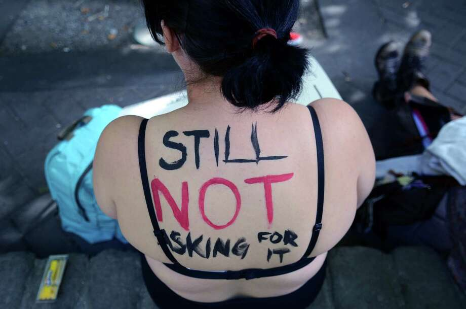 Attendees painted themselves with signs and slogans during the annual Slutwalk march Sunday, Aug. 25, 2013, in Seattle. Attendees of the walk protested rape culture and gender-based violence in the United States. Photo: SY BEAN, SEATTLEPI.COM / SEATTLEPI.COM