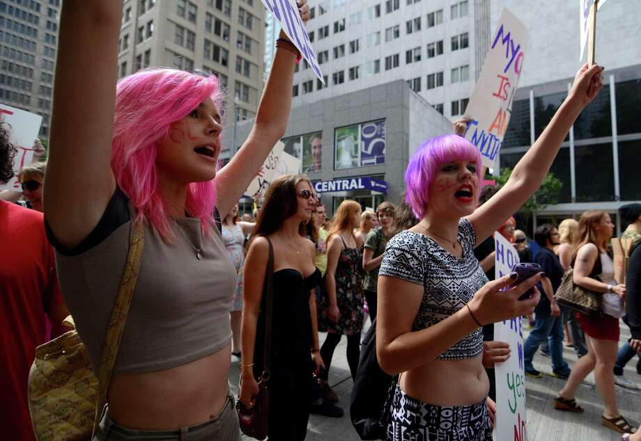 Attendees chanted in protest with signs and slogans during the annual Slutwalk march Sunday, Aug. 25, 2013, in Seattle. Attendees of the walk protested rape culture and gender-based violence in the United States. Photo: SY BEAN, SEATTLEPI.COM / SEATTLEPI.COM