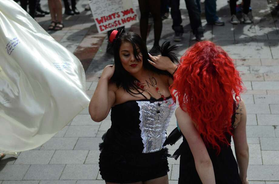 Attendees danced in protest during the annual Slutwalk march Sunday, Aug. 25, 2013, at the Westlake Center in Seattle. Attendees of the walk protested rape culture and gender-based violence in the United States. Photo: SY BEAN, SEATTLEPI.COM / SEATTLEPI.COM