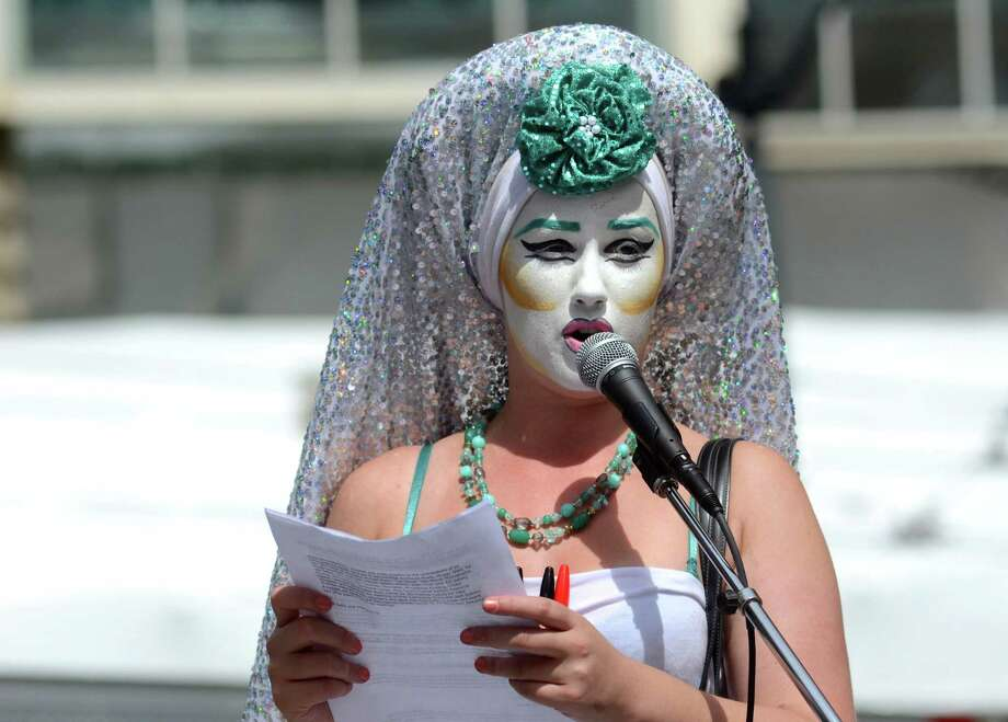 "Sister Beyonce Ving speaks to the crowd about her ""Shame Veil"" she wore during the annual Slutwalk march Sunday Aug. 25, 2013 in Seattle. Each veil has the written memories of victims to rape. Photo: SY BEAN, SEATTLEPI.COM / SEATTLEPI.COM"